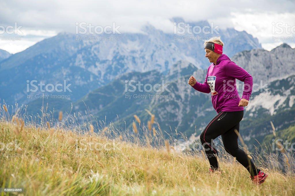 Woman running on mountain stock photo
