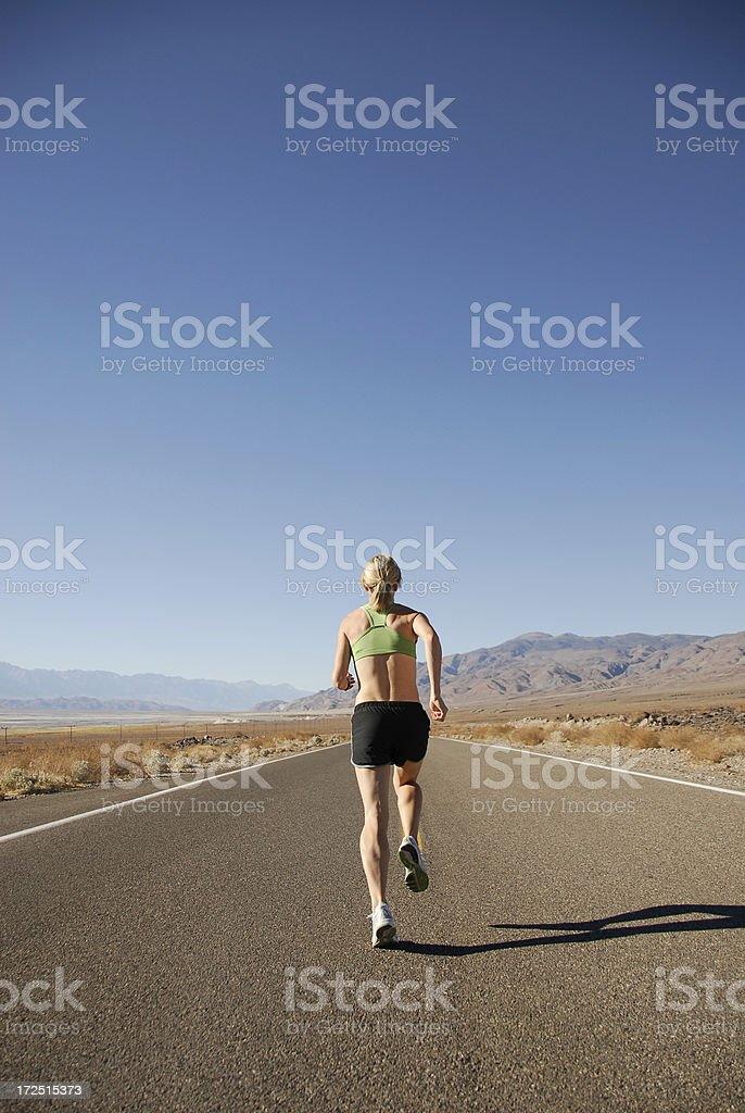 Woman Running on Road royalty-free stock photo