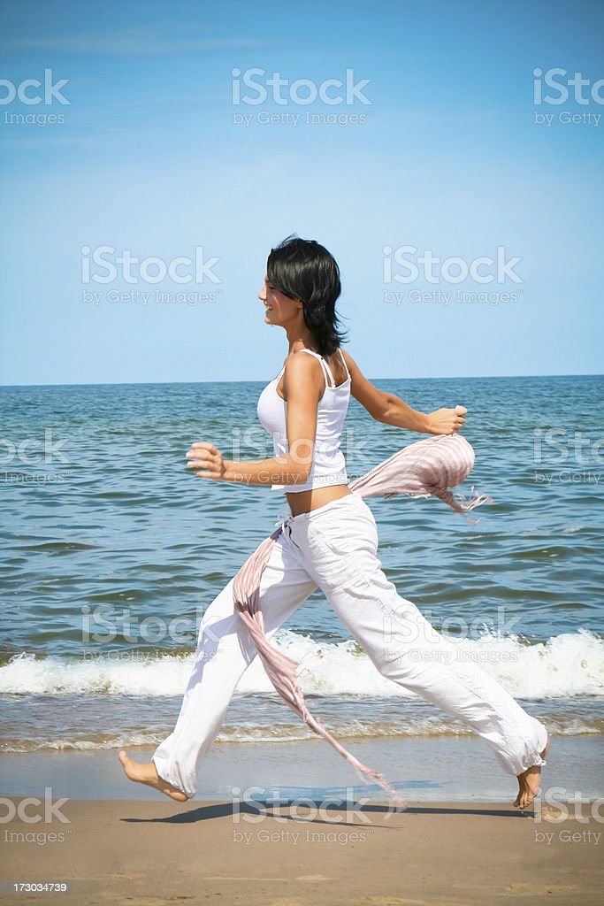 Woman Running on the Beach royalty-free stock photo