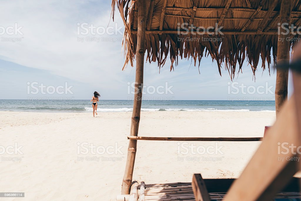Woman Running On The Beach. stock photo