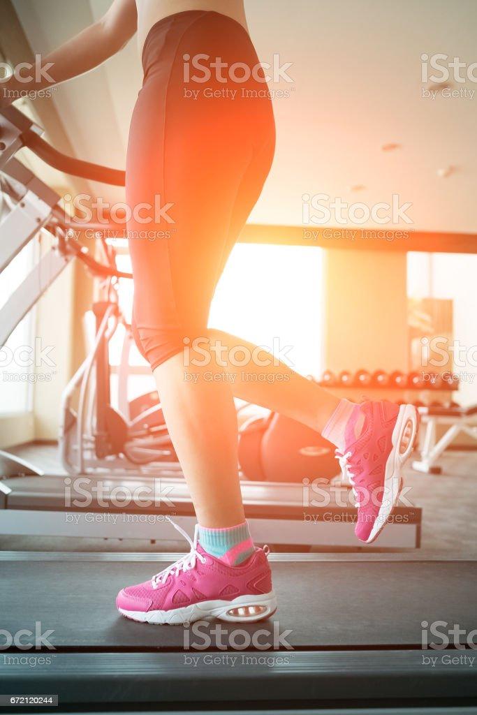 woman running on treadmill stock photo