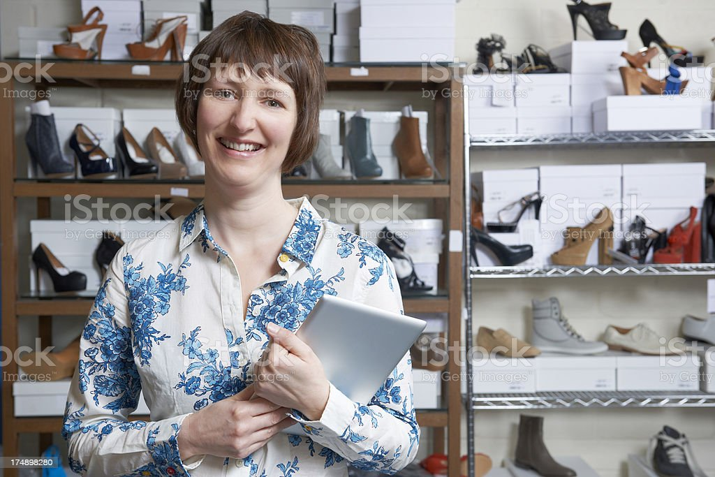 Woman Running Online Shoe Business royalty-free stock photo