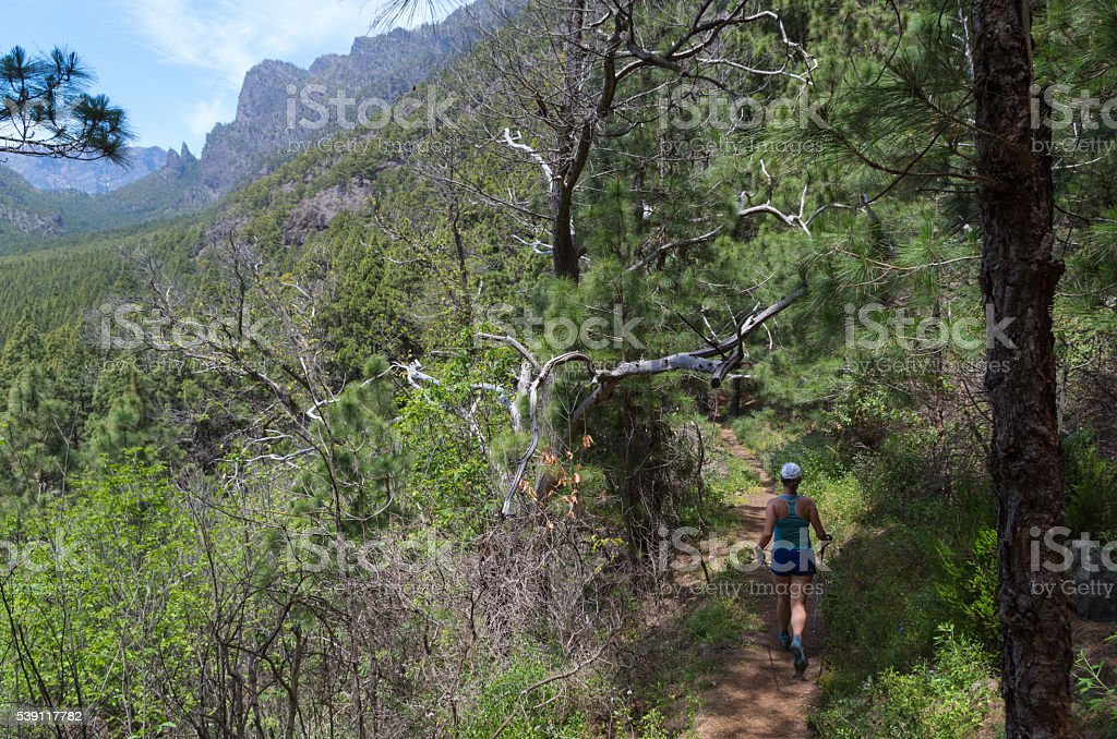 Woman running or hiking in the mountains of la palma stock photo