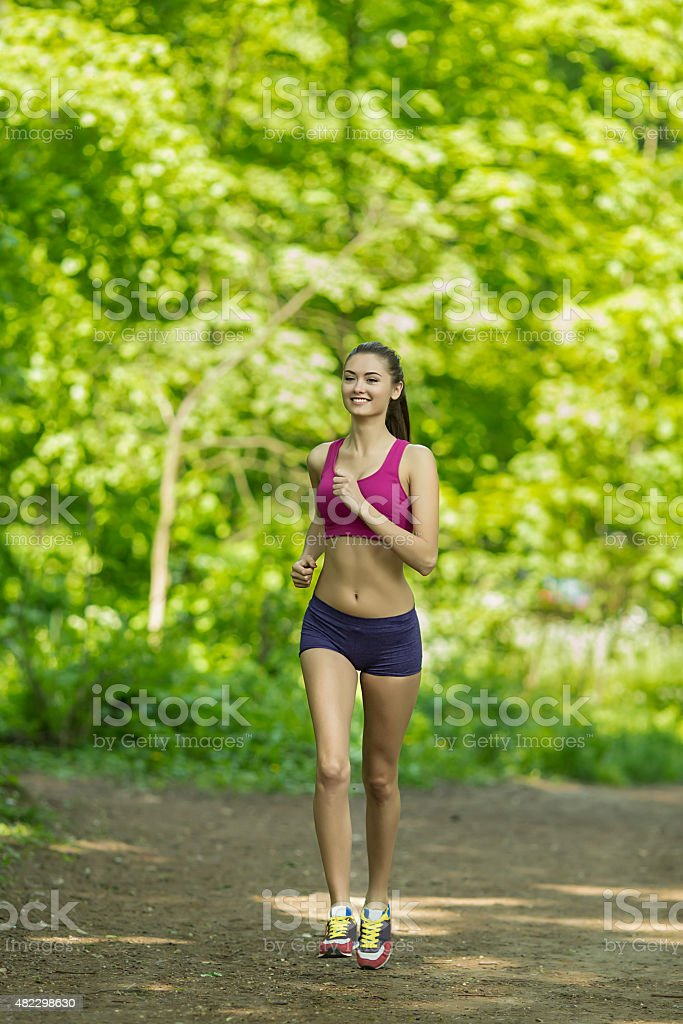 woman running outdoors royalty-free stock photo