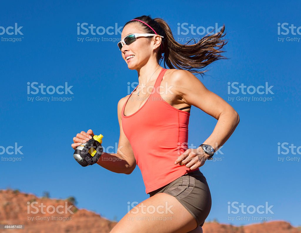 Woman Running Outdoors stock photo