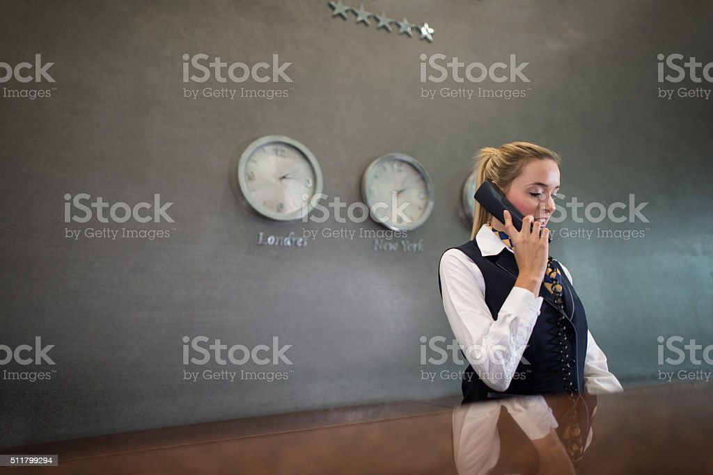 Woman running the front desk at a hotel stock photo