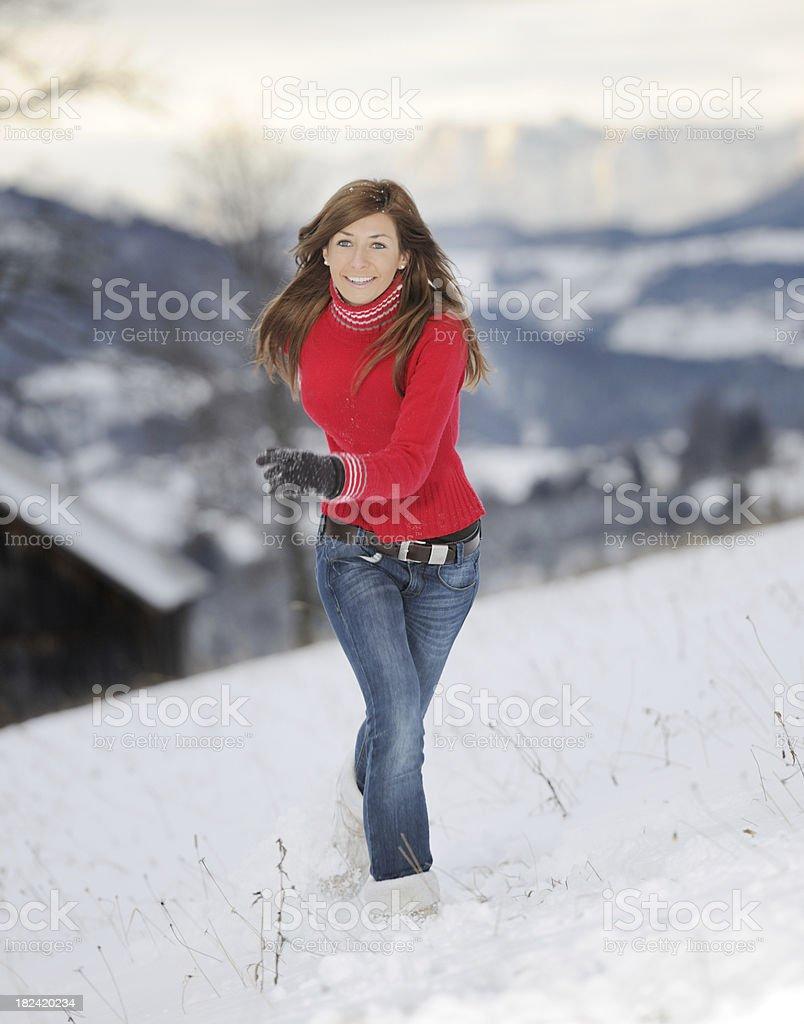 Woman running through fresh powder Snow (XXXL) royalty-free stock photo