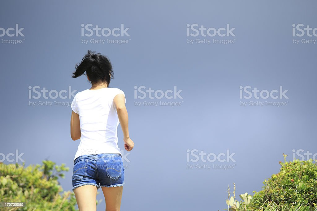woman running to mountain top royalty-free stock photo
