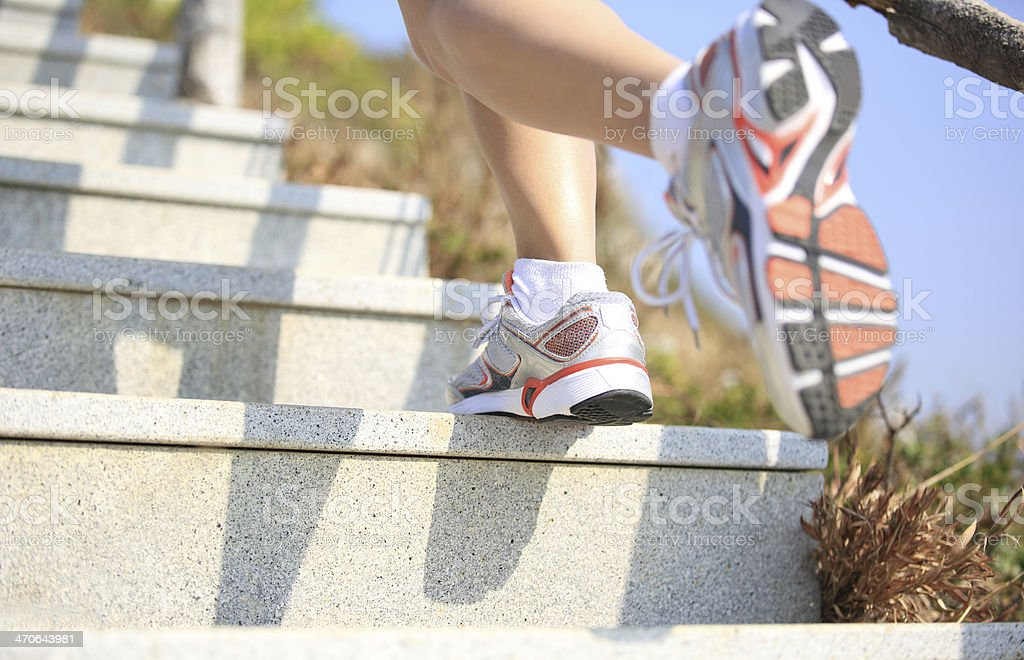 woman running up at mountain stairs royalty-free stock photo