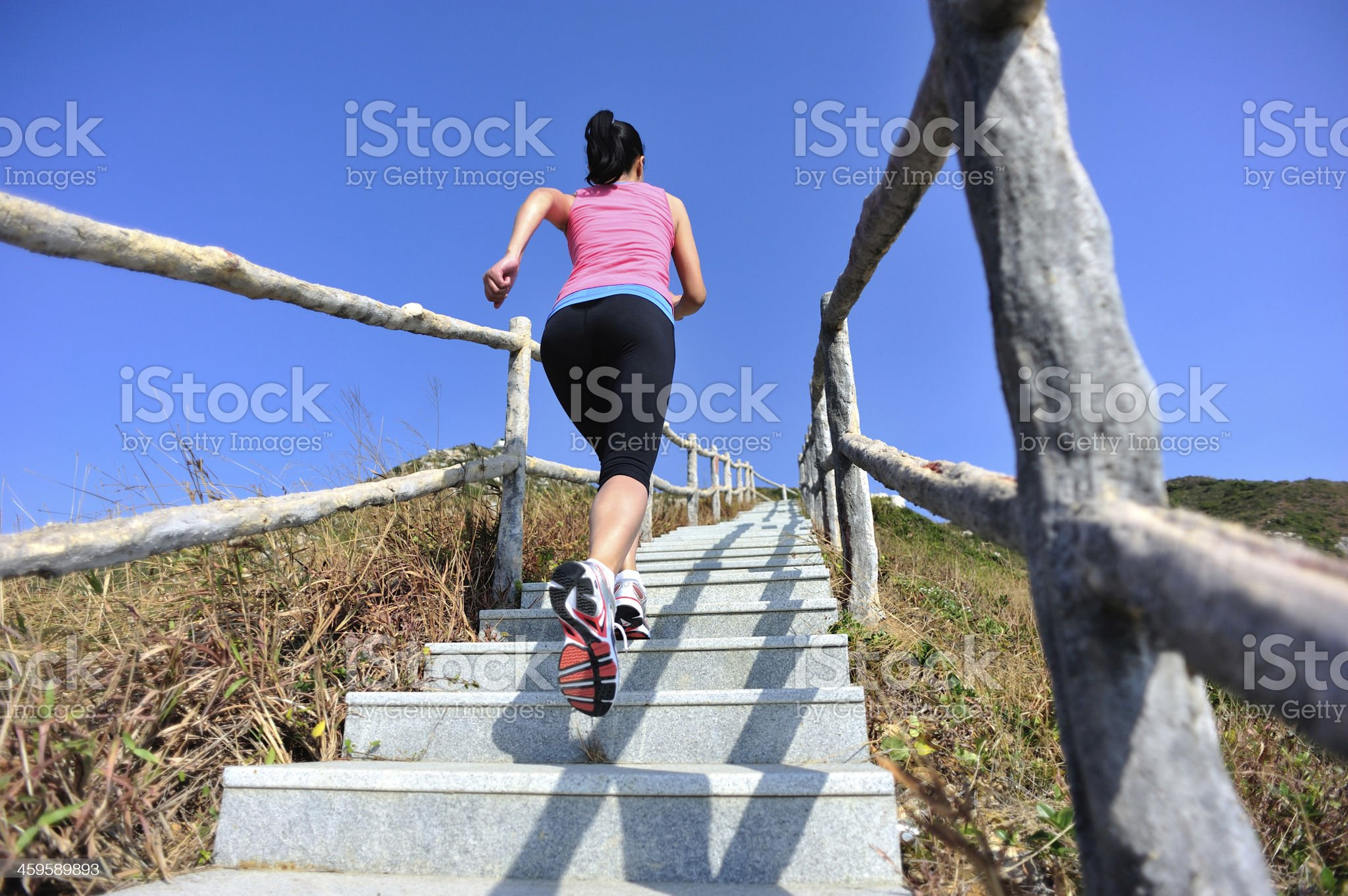 woman running up on mountain stairs royalty-free stock photo