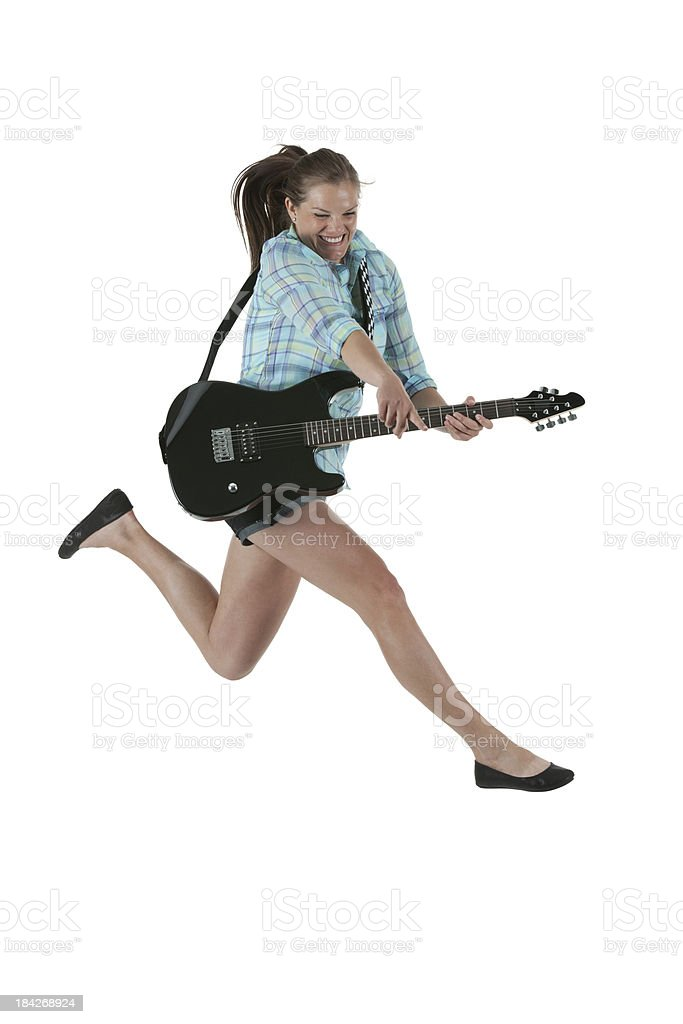 Woman running with a guitar stock photo
