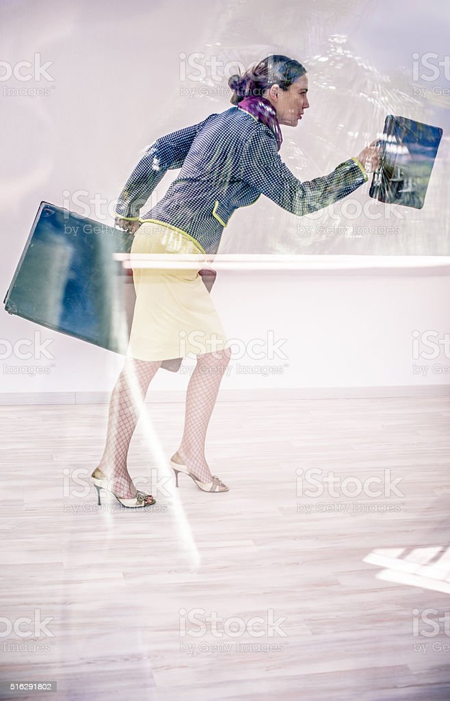 Woman running with suitcases stock photo