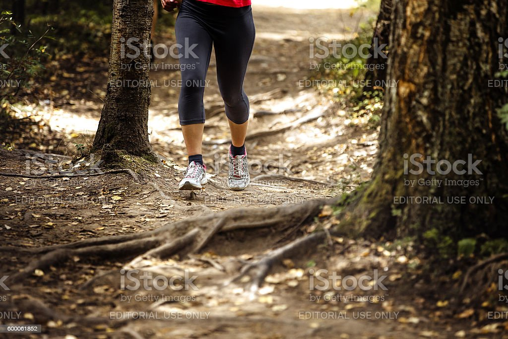woman runs in woods trail royalty-free 스톡 사진