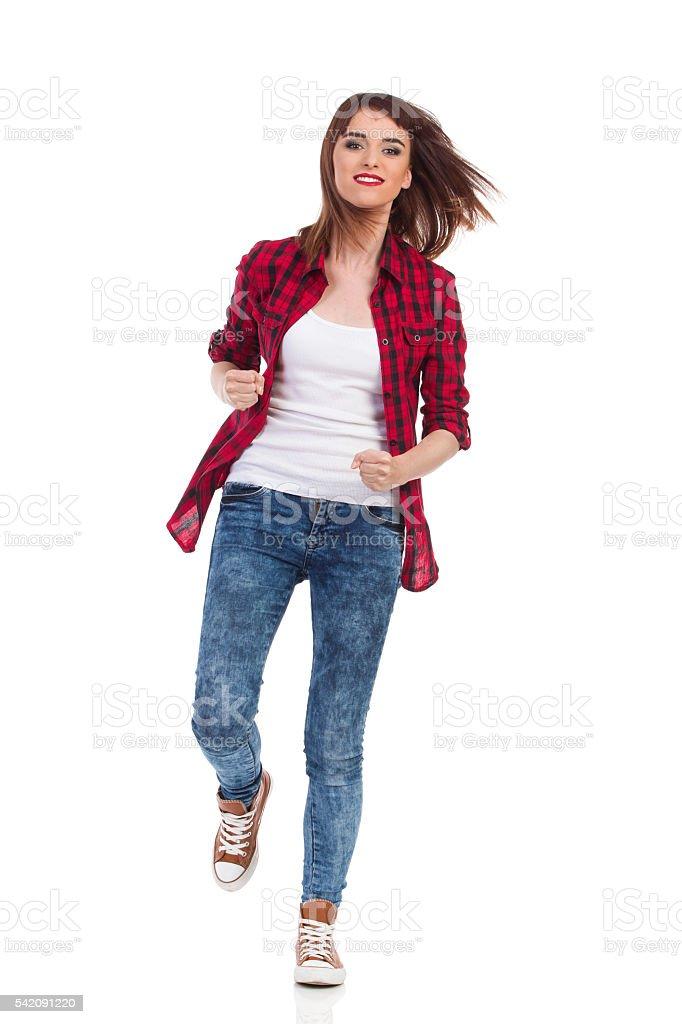 Woman Runs Towards The Camera stock photo