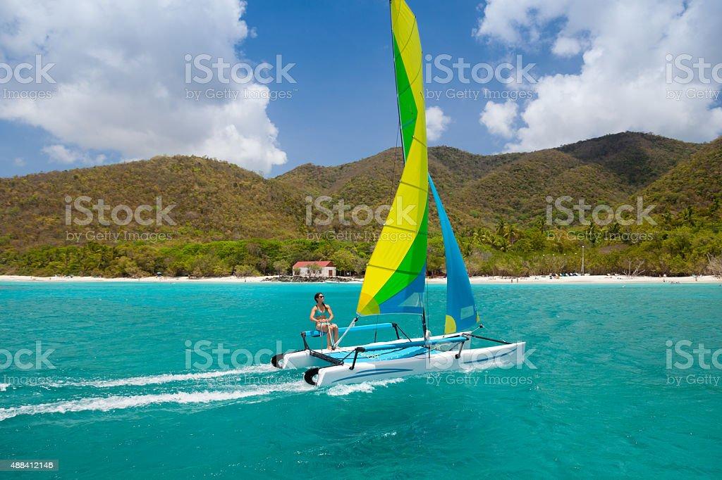 woman sailing a catamaran in Cinnamon Bay, St.John, USVI stock photo