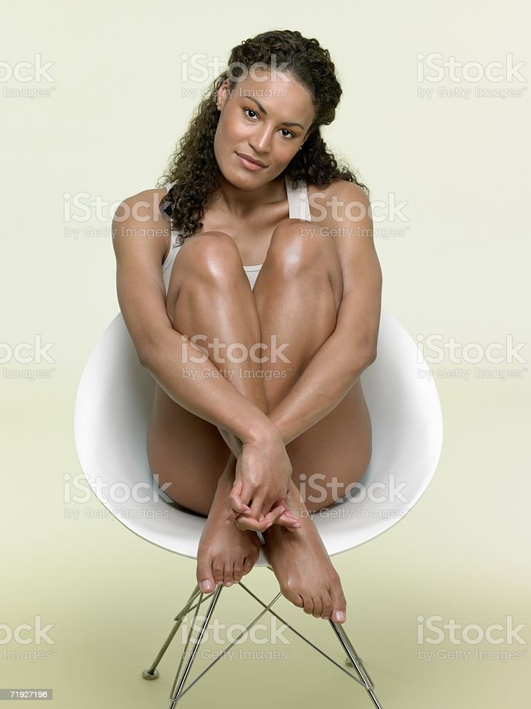 Woman sat in chair stock photo