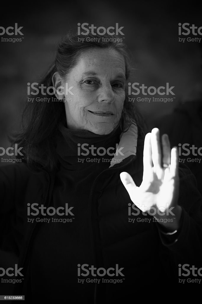 Woman saying no, stop, with hand gesture stock photo