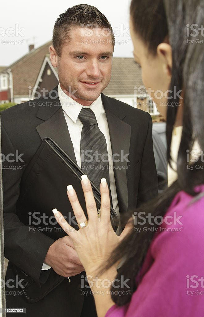 Woman Saying No to  Salesman stock photo