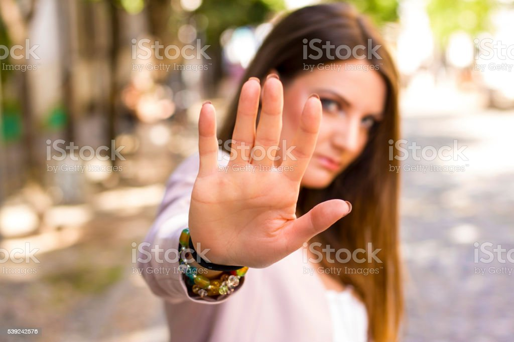 woman says stop stock photo