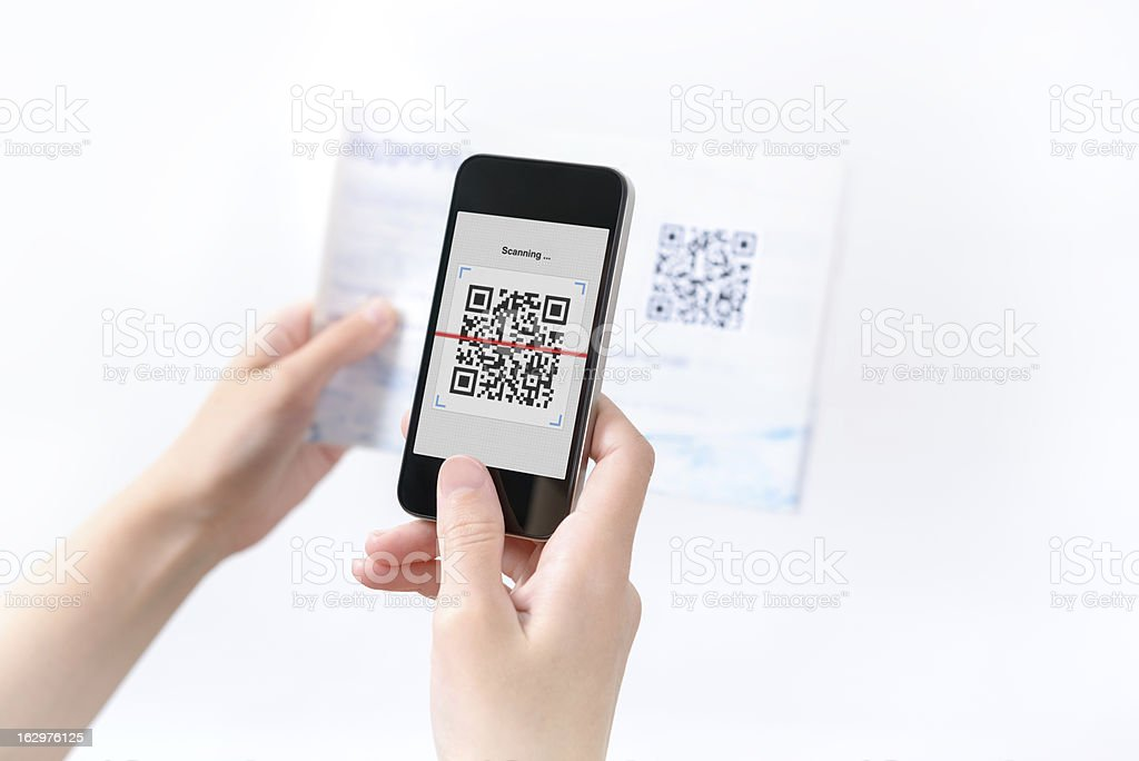 Woman scanning QR code in the magazine stock photo