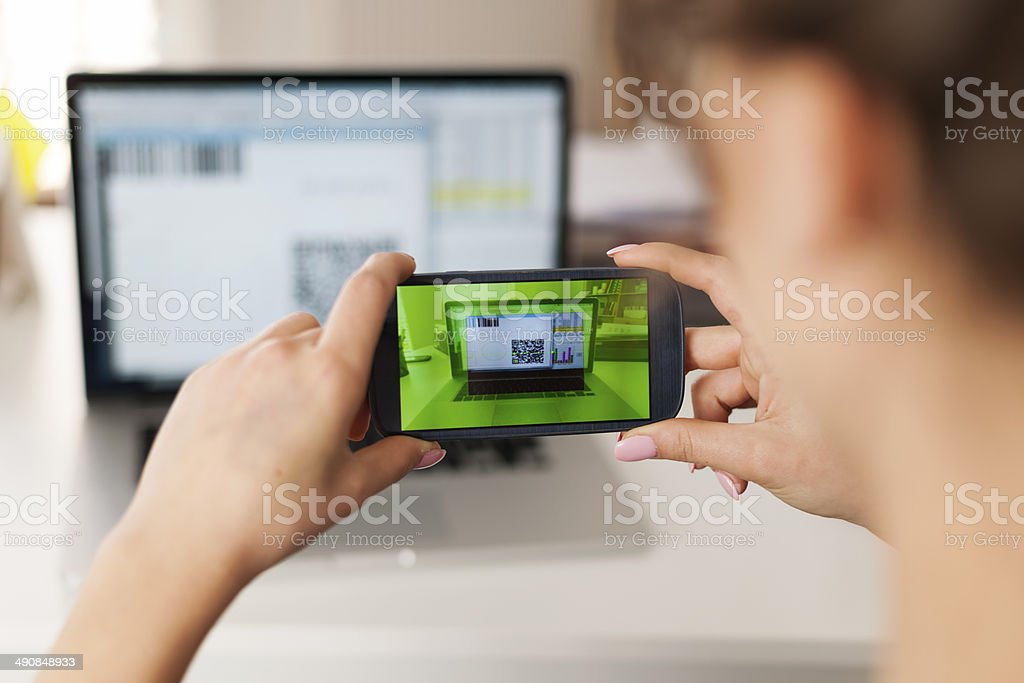 Woman scanning qr code to pay bills stock photo