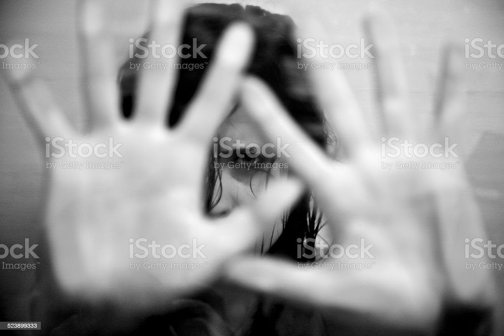 Woman scared about abuse and violence stock photo