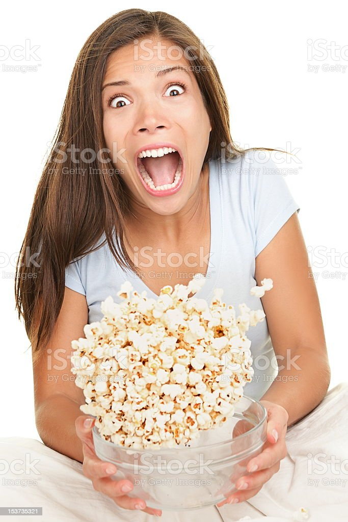 Woman scared funny watching movie royalty-free stock photo
