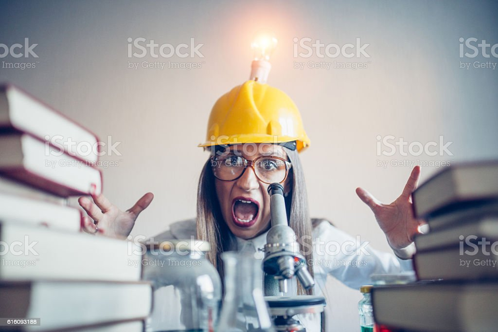 Woman scientist screaming stock photo