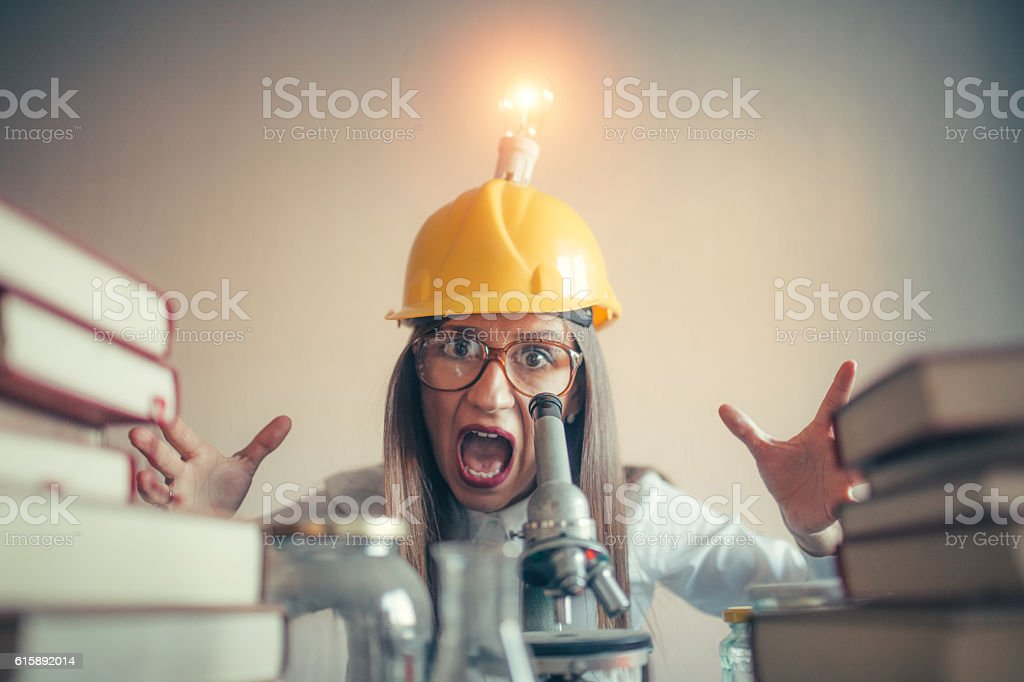 Woman scientist shouting stock photo