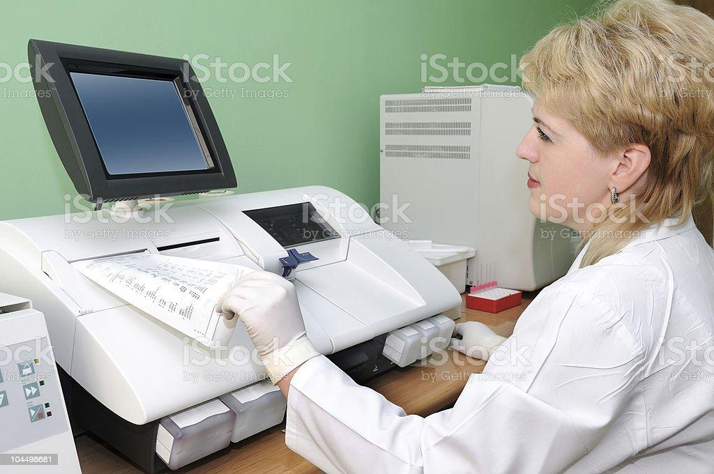 woman Scientist using medical equipment stock photo