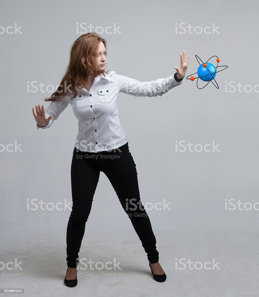 Woman scientist with atom model, research concept stock photo
