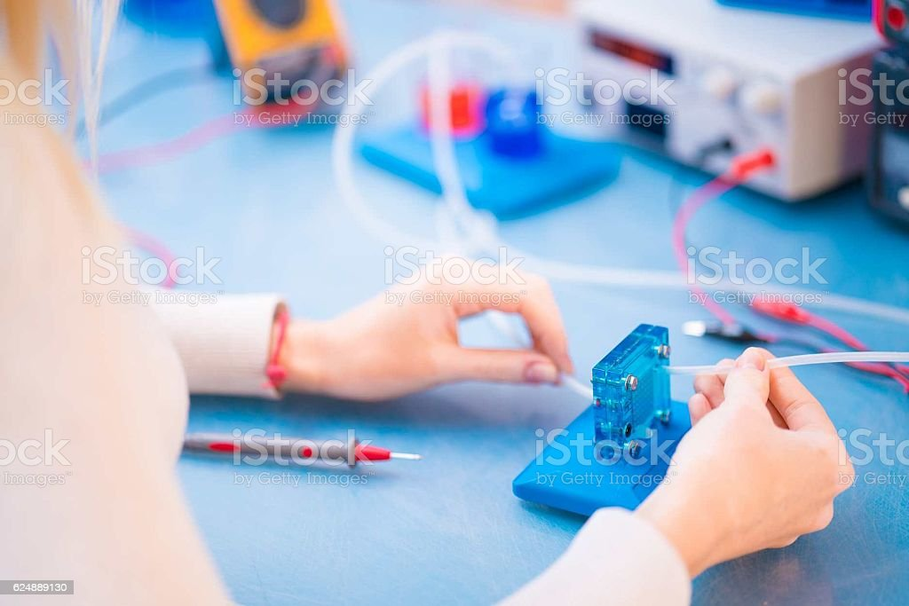Woman scientist with stock photo