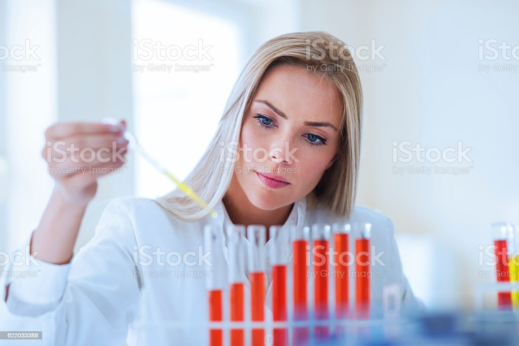 Woman scientist working in laboratory stock photo