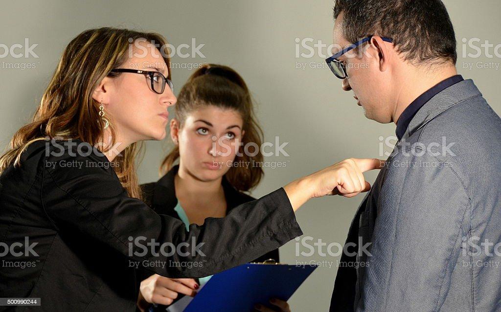 Woman scolding an employee stock photo