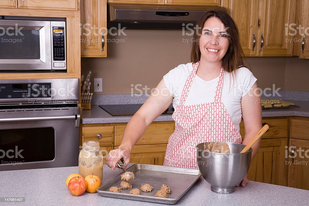 Woman scooping out cookies royalty-free stock photo