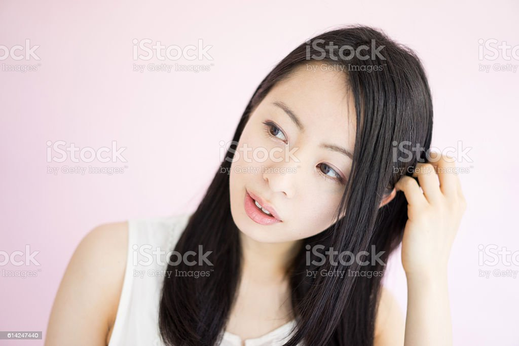 Woman scratching head stock photo