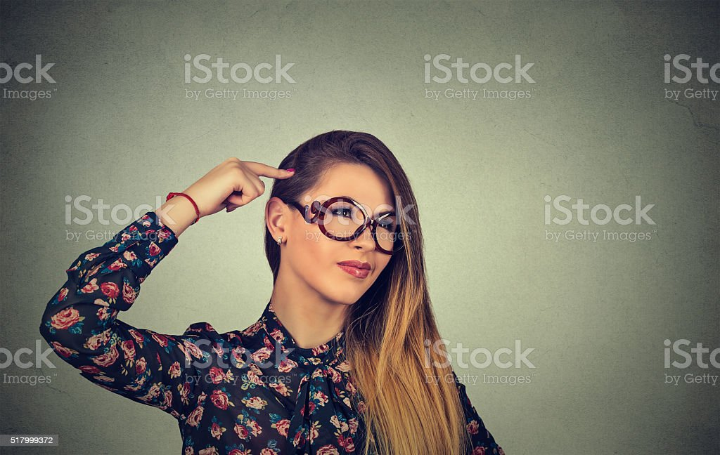 woman scratching head, thinking about something stock photo