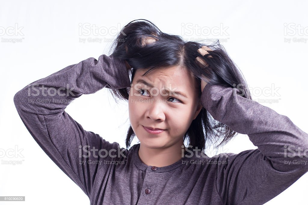 Woman Scratching Her Head on Isolated White Background stock photo