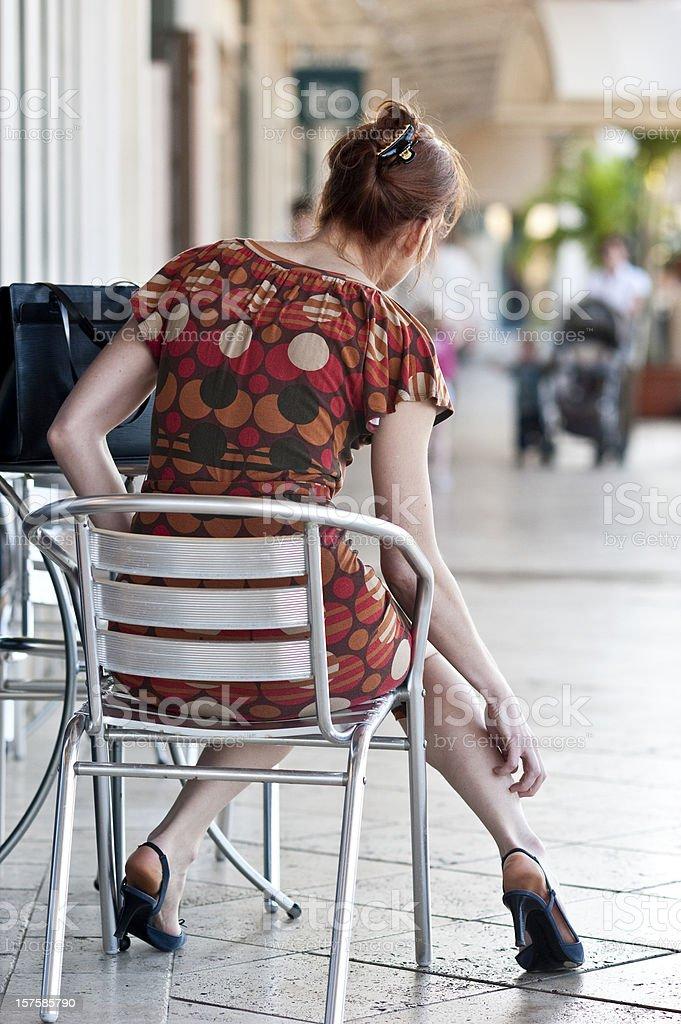 woman scratching her leg stock photo