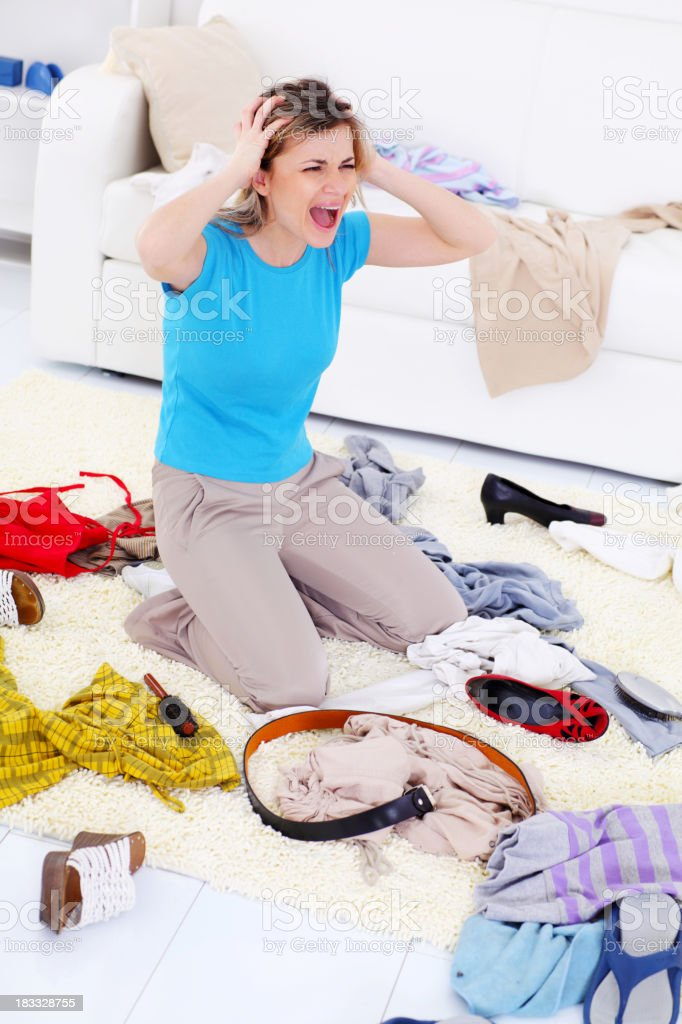 Woman screaming about the mess in room. royalty-free stock photo
