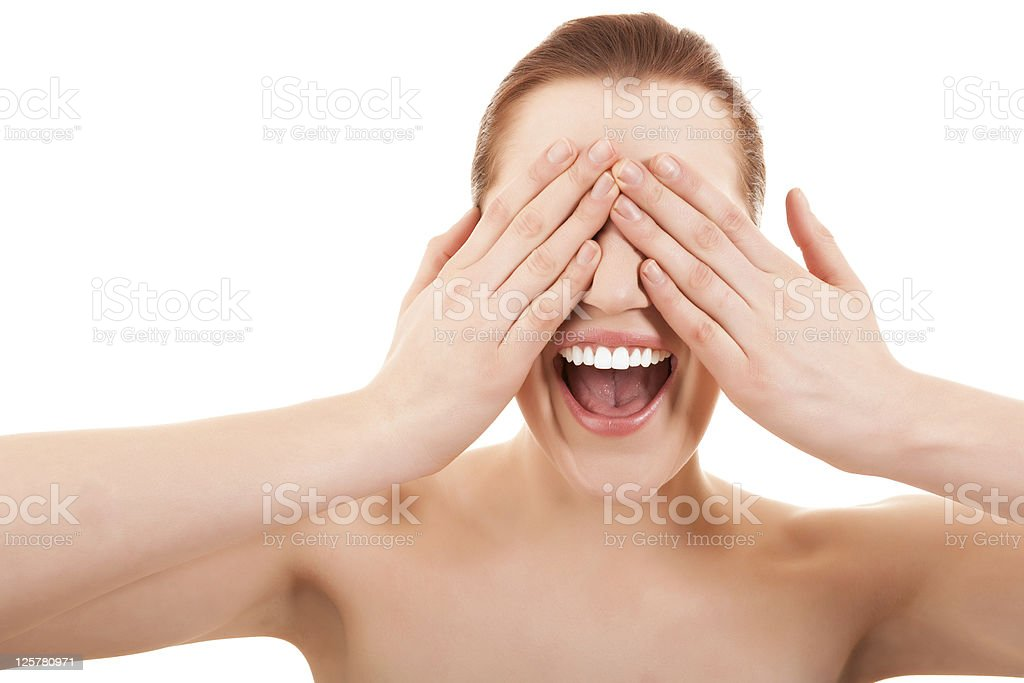 Woman screaming and covering her eyes stock photo