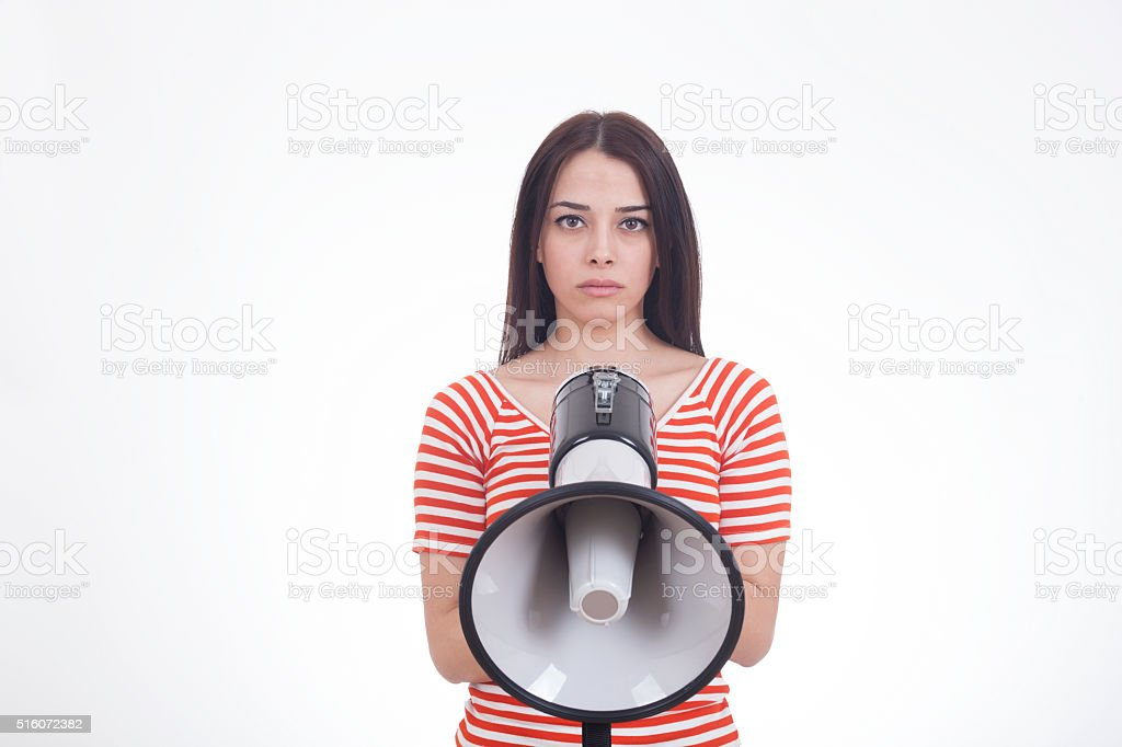 Woman Screaming in Megaphone stock photo