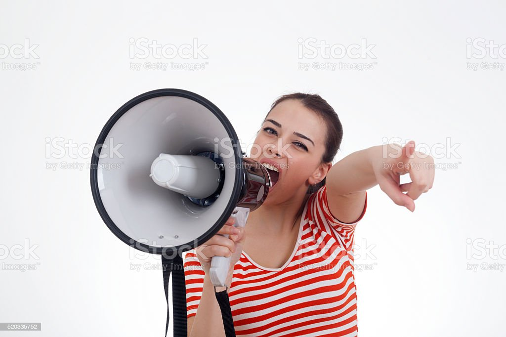Woman Screaming in Megaphone stock photo