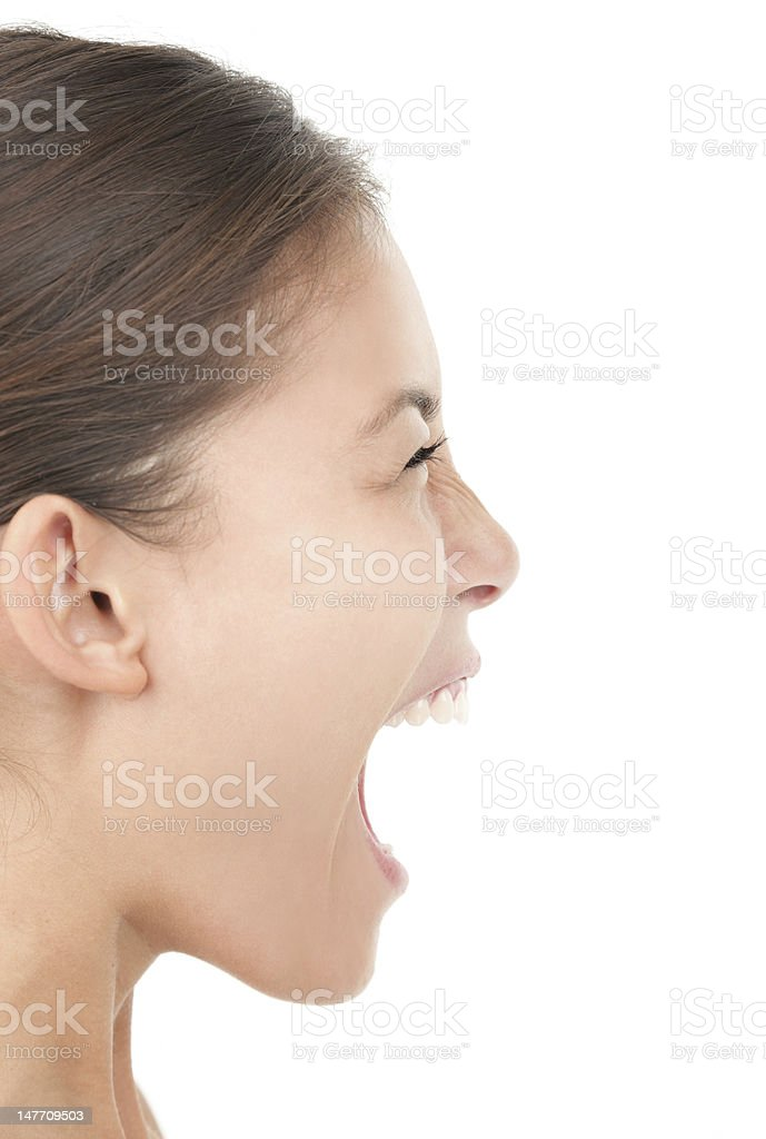 Woman screaming on white background stock photo