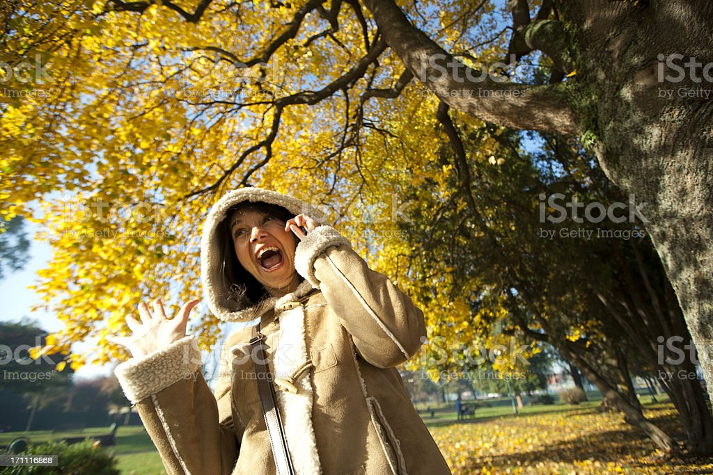 woman screaming with a mobil phone stock photo