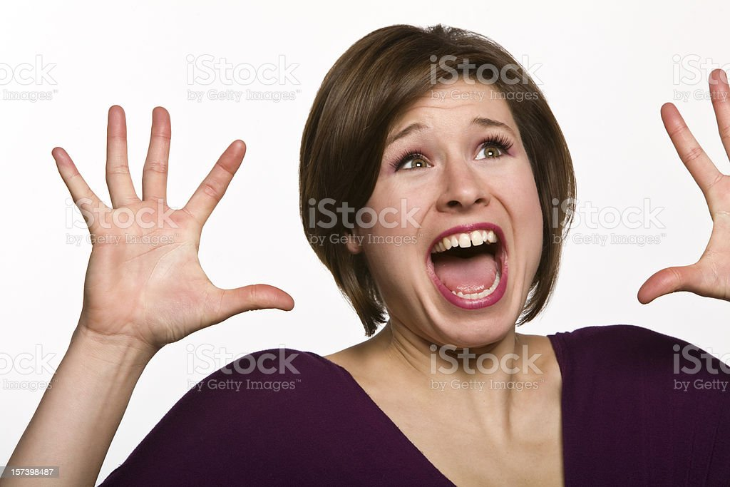 Woman Screaming with Hands Up in Air royalty-free stock photo