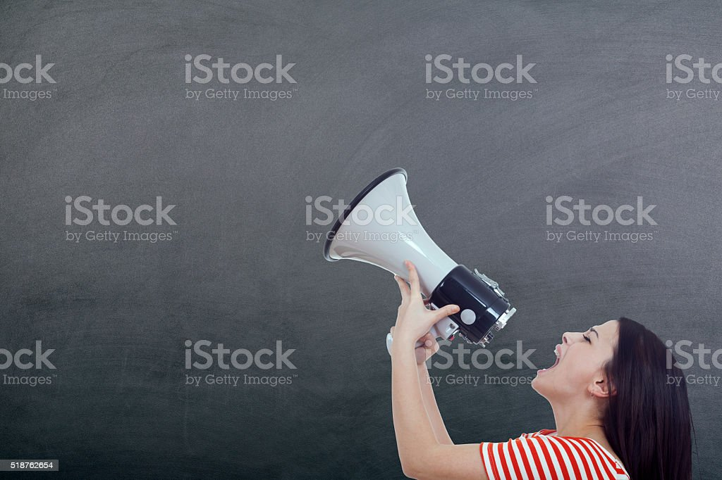 Woman Screaming with Megaphone on Chalkboard stock photo