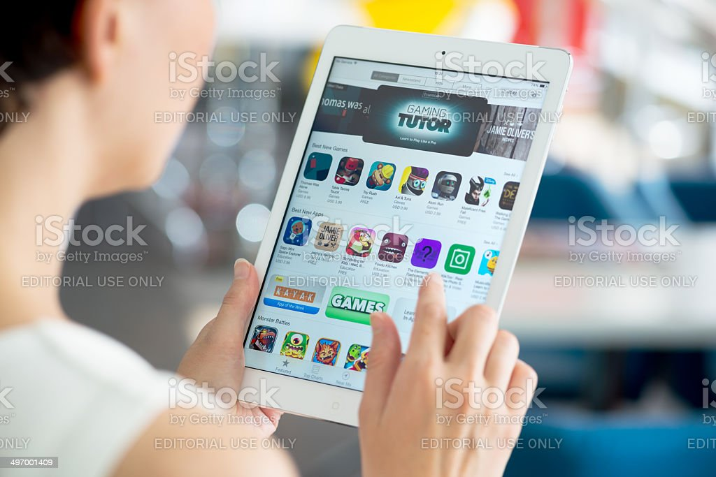 Woman searching for apps on tablet stock photo