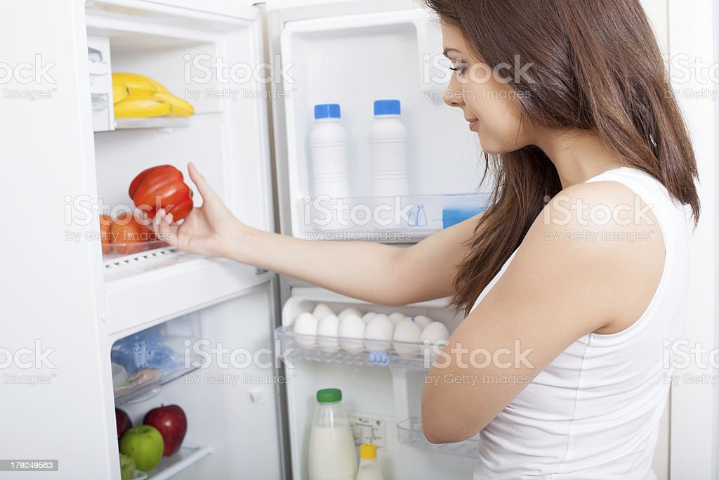 Woman searching in her fridge royalty-free stock photo