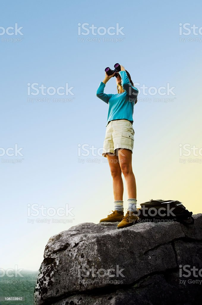 Woman Searching on Mountain Top royalty-free stock photo